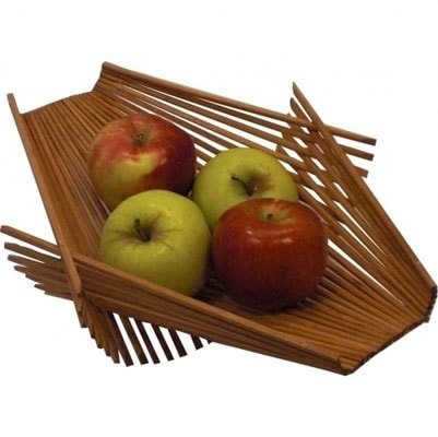 This sustainable basket woven from actual chopsticks looks like a Campana brothers design. The versatile, flexible shape makes it mighty enough to hold piles of fruit, vegetable, and bread, or stand alone as a chic centerpiece on a table. If you're feeling really crafty and happen to have a draw full of take-out chopsticks, you could make it yourself. Glue sticks together in two sections and interlace the edges to create a true DIY original.