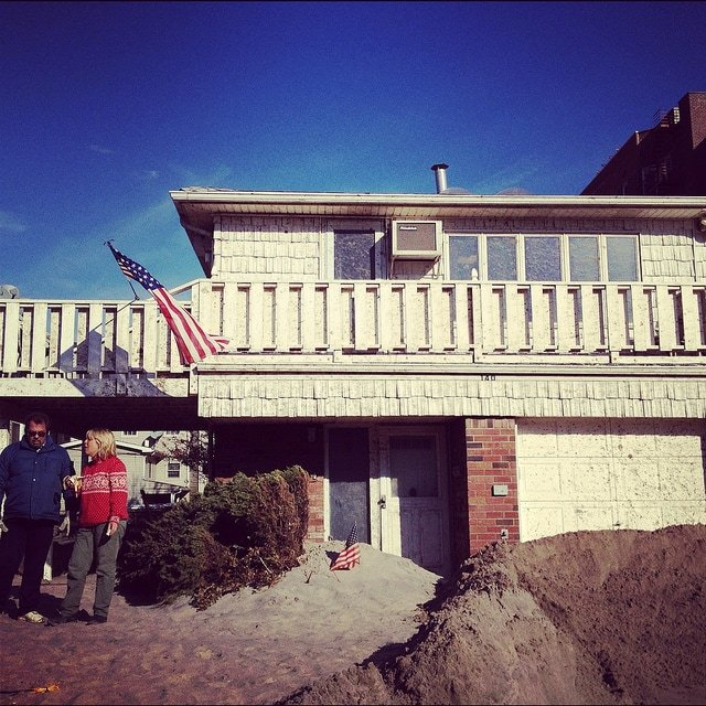 Rockaway residents in front of their home
