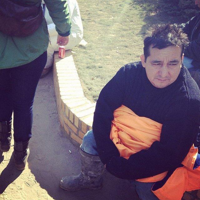 A Sandy survivor clutches his marathon jacket