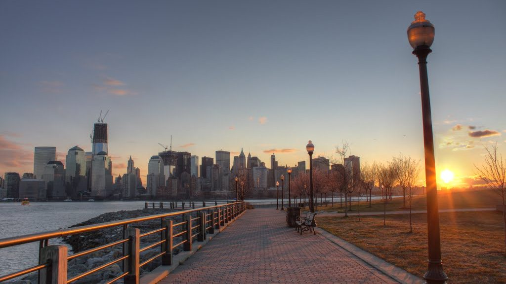 Sunrise at Liberty State Park with view of city skyline
