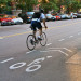 A man makes use of a dedicated bike lane on Christopher St. thumbnail