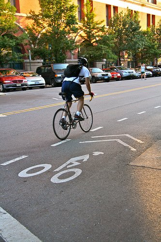 A man makes use of a dedicated bike lane on Christopher St.