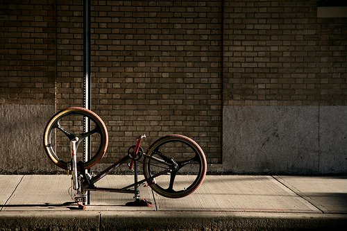 A bike sits waiting for its owner to return under a bridge in southwestern Manhattan.