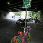 A yarn-bombed bike sits on display under the Brooklyn Bridge overpass in DUMBO.