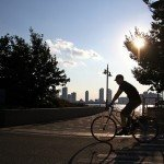 A man bikes the Manhattan Waterfront Greenway in western Manhattan.