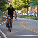 A man bikes the Manhattan Waterfront Greenway in western Manhattan. thumbnail
