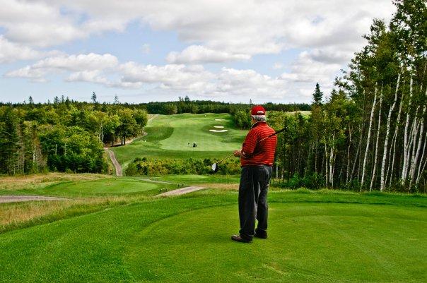 golfer in red shirt