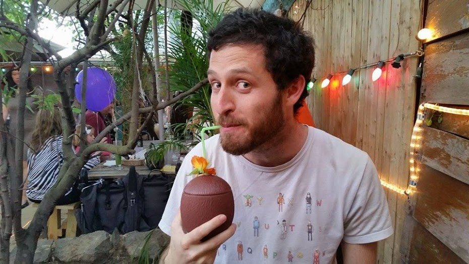 Rob drinking out of a Coconut