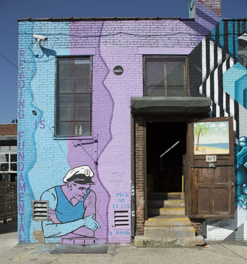 sailor next to open door street art for the bushwick collective by franck duval