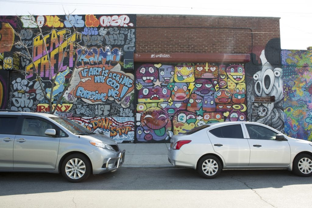 the bushwick collective street art two cars