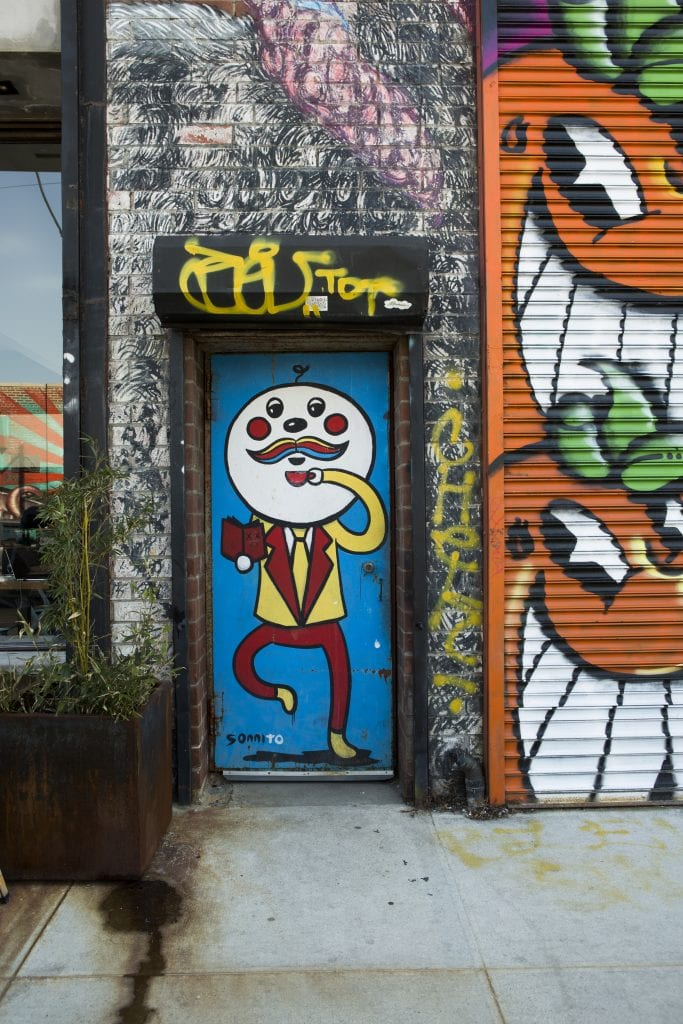 the bushwick collective street art doorway and gate by sonni