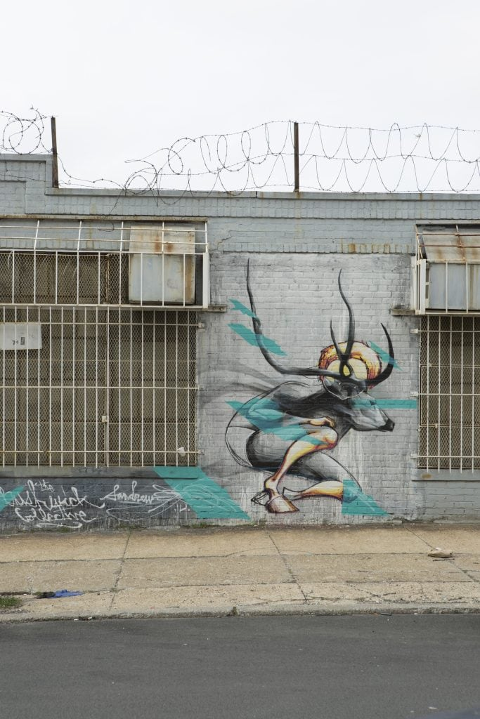 the bushwick collective street art deer antlers morphed human mural