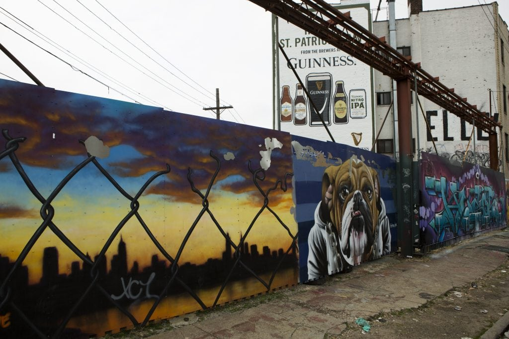 the bushwick collective street art bulldog and city skyline
