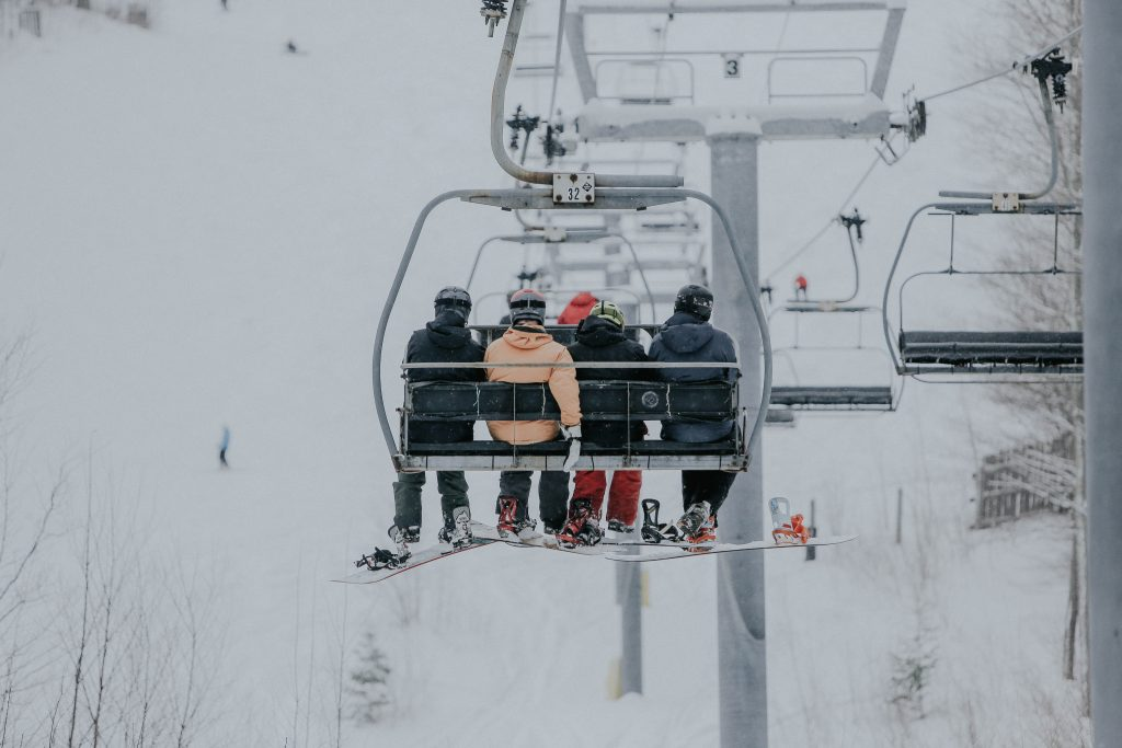 Snowboarders on a chair lift at Hunter Mountain, NY